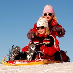 Girls sledding-250x250